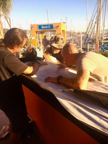 Francisco, Diego and our new friend patching up the jib